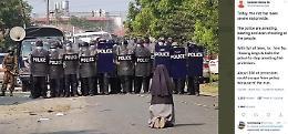 Birmania: foto icona di suora in ginocchio davanti a polizia